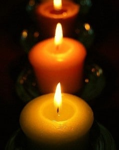 Closeup of Lit Candles in the Dark